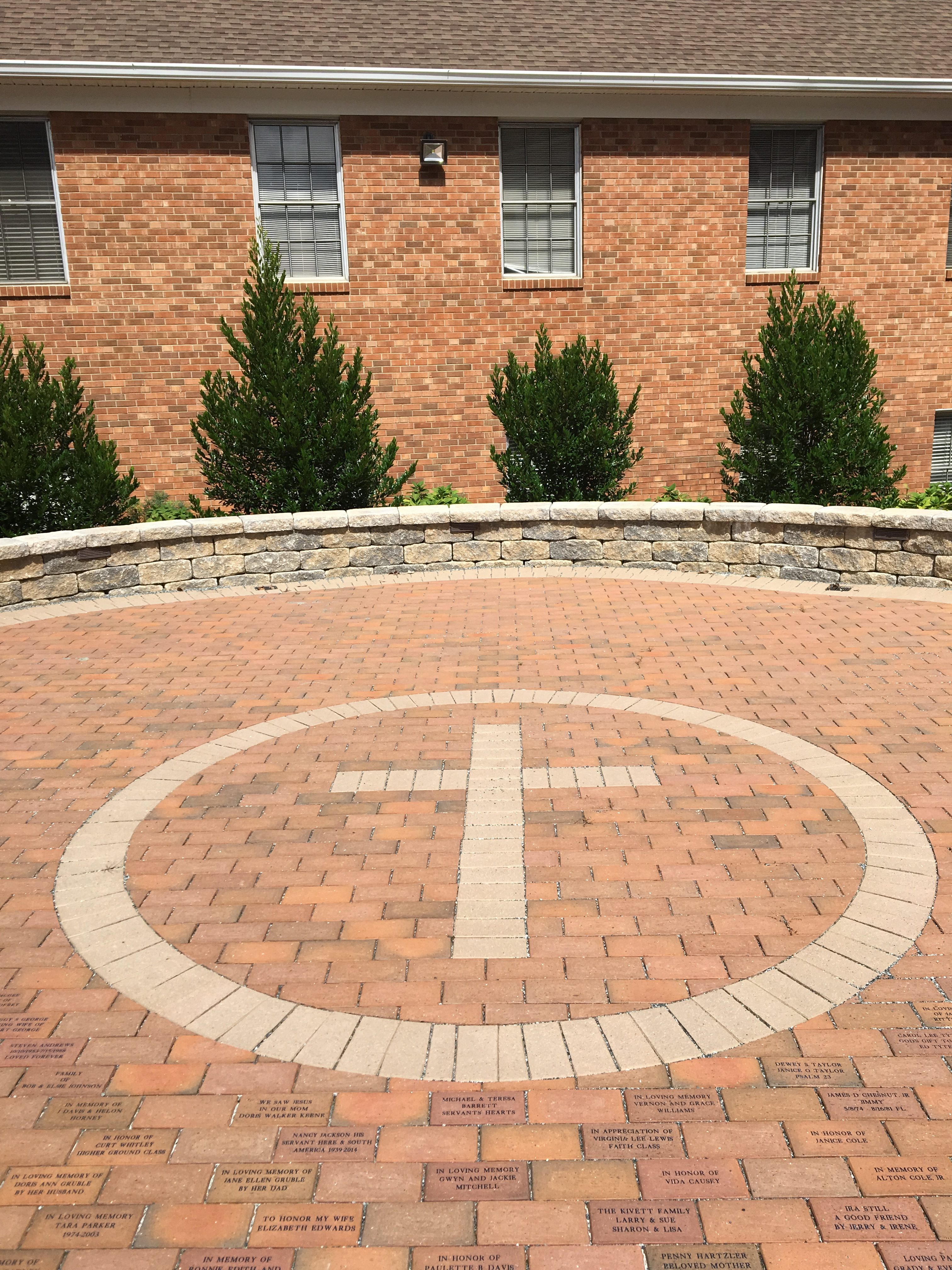 clay pavers create cross motif in memorial garden