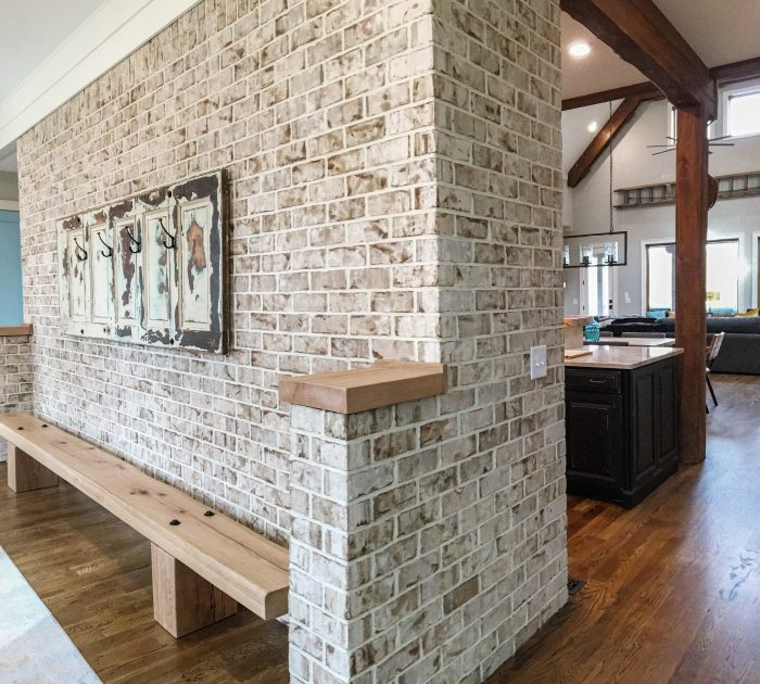 Interior Brick Accents And Defines Open Floor Plan In Modern Rustic Home